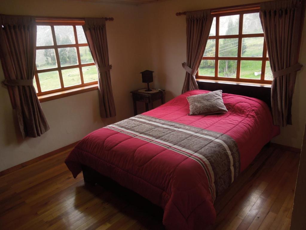 A bed or beds in a room at Hostería La Condesa