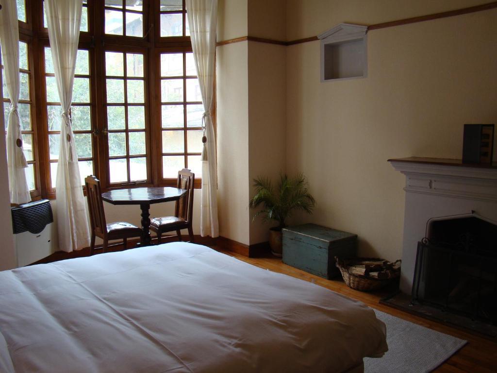 A bed or beds in a room at Hotel Boutique El Consulado