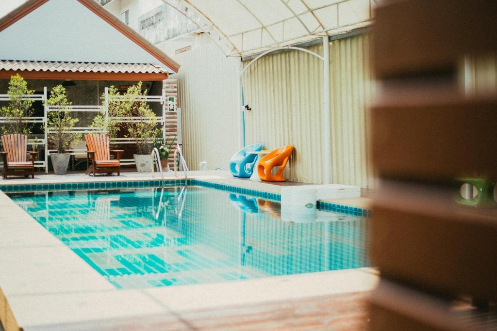 The swimming pool at or near Pai Sukhothai Resort