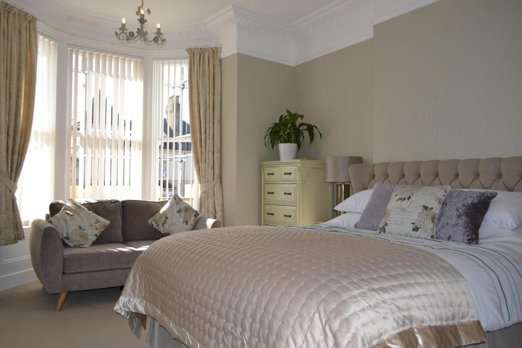 A bed or beds in a room at The Westbourne Guest House