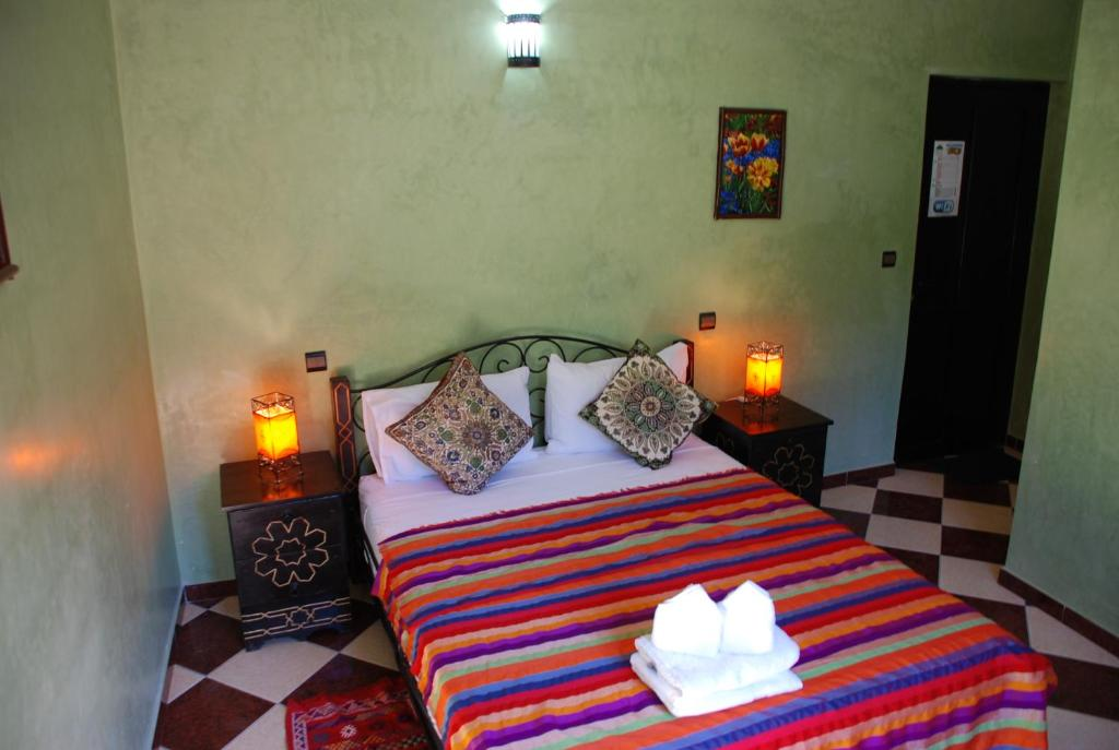 A bed or beds in a room at Maison d´hôtes Amazir