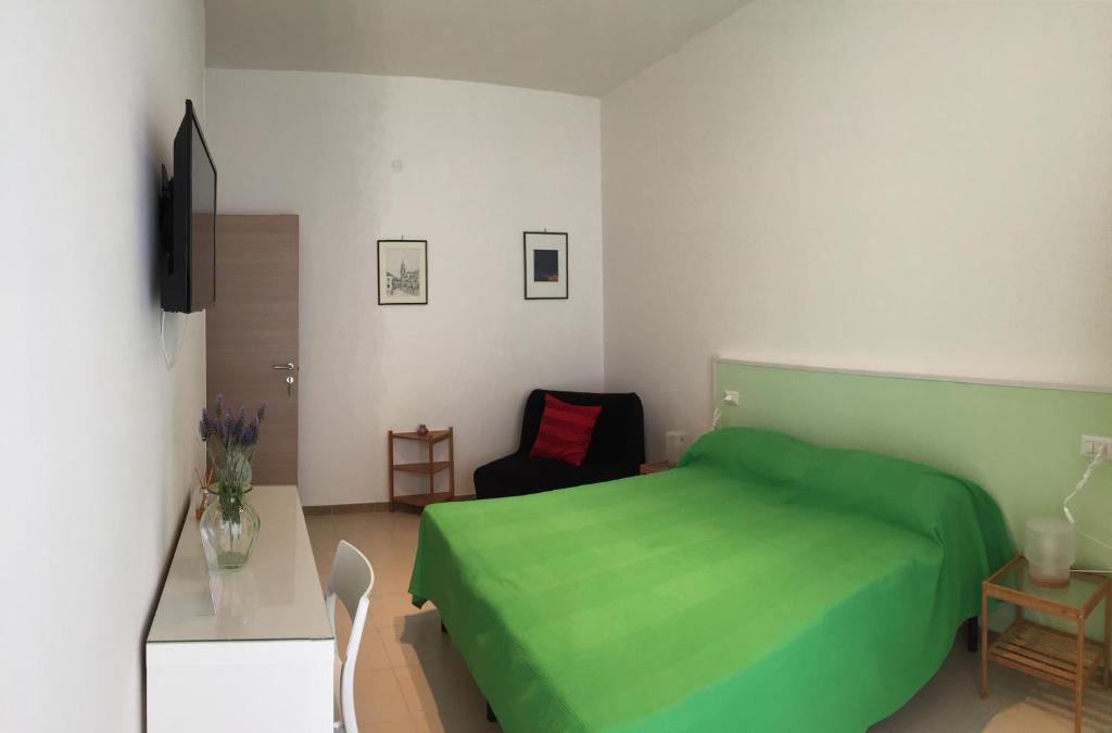 A bed or beds in a room at Sorgente 23
