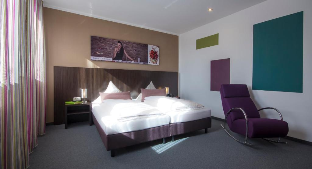 A bed or beds in a room at GS Hotel