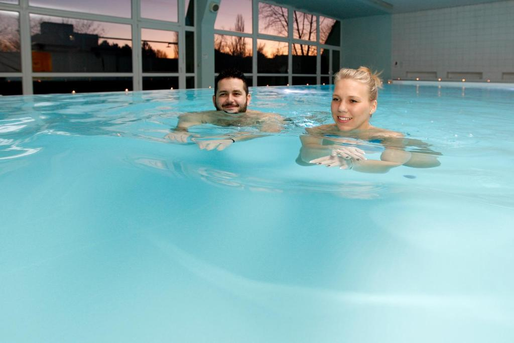 The swimming pool at or near Hotel Máj Spa&Wellness