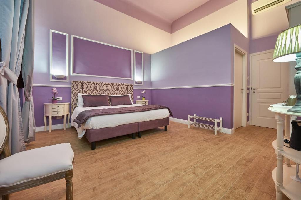 A bed or beds in a room at B&B Le Stanze del Duomo