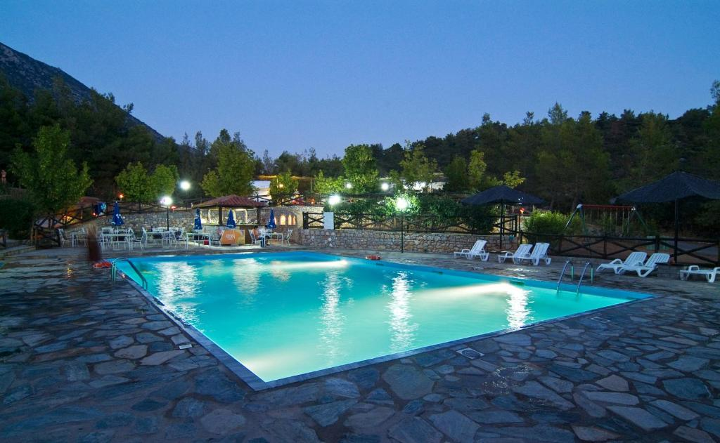 The swimming pool at or close to Bungalow - Camping Apollon