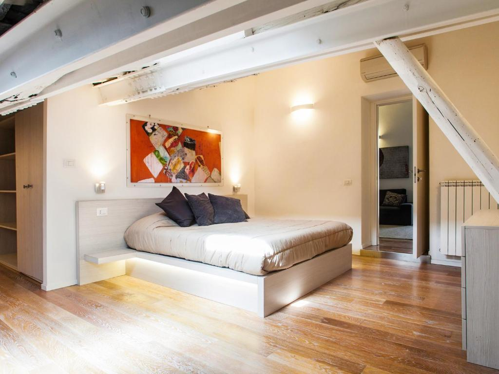 A bed or beds in a room at Spanish Steps Luxury Penthouse
