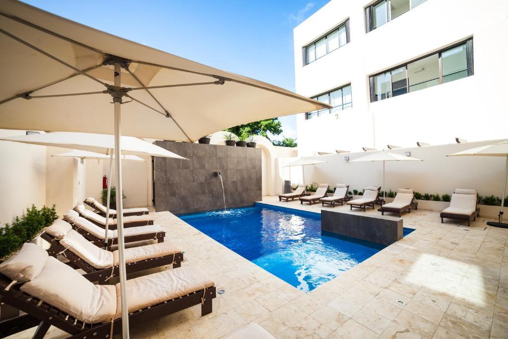 The swimming pool at or near Aspira Hotel & Beach Club