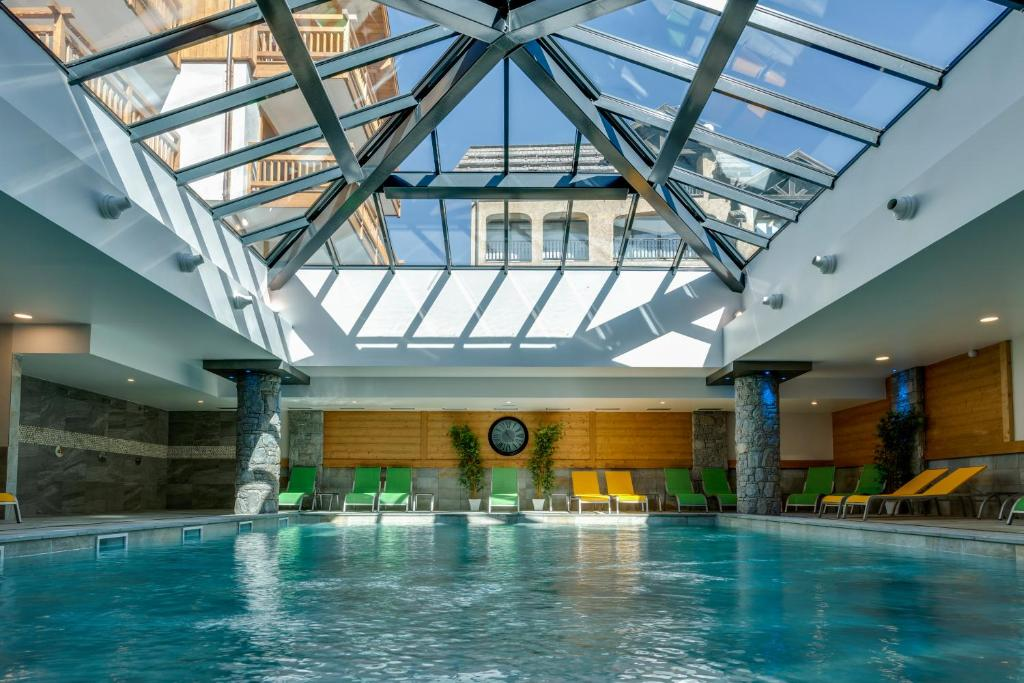 The swimming pool at or near CGH Résidences & Spas Le Napoléon