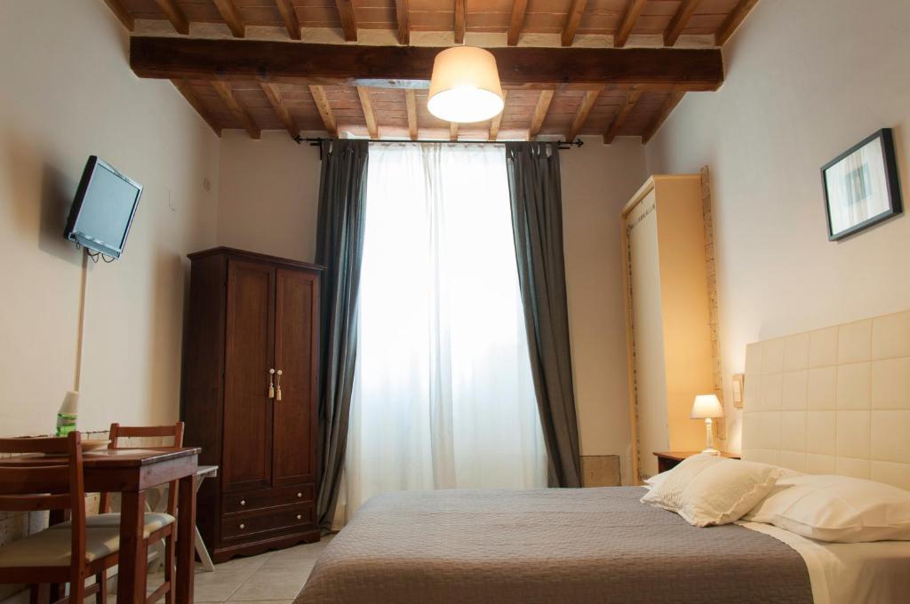 Letto o letti in una camera di Bed & Tower