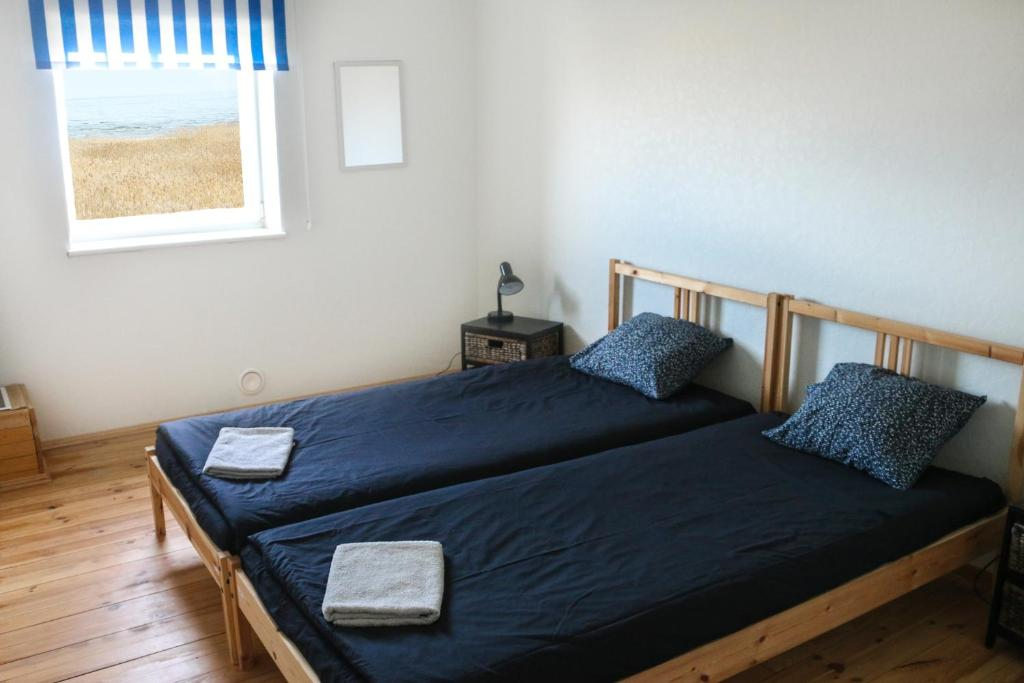 A bed or beds in a room at Mazā Kaija