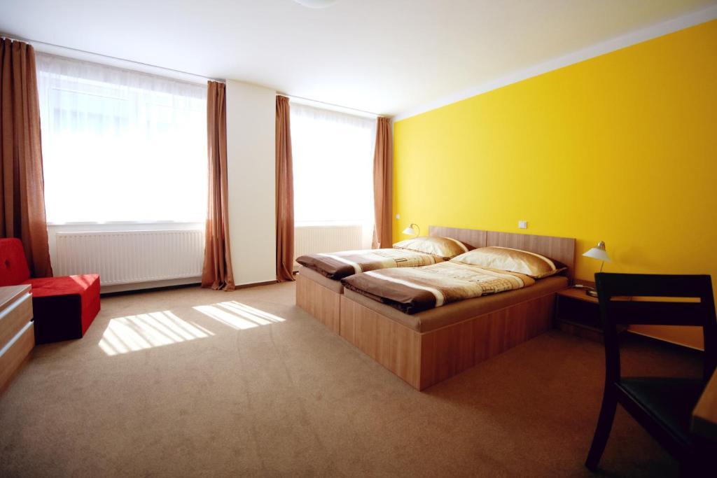 Кровать или кровати в номере Hotel Fabrika