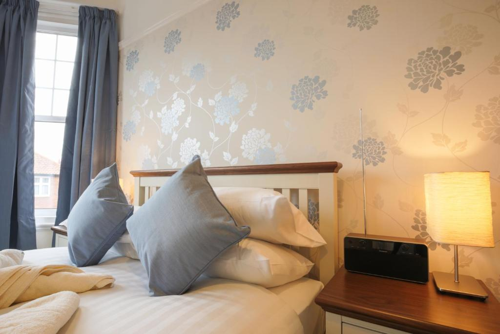 A bed or beds in a room at Bootham City Centre Guest House