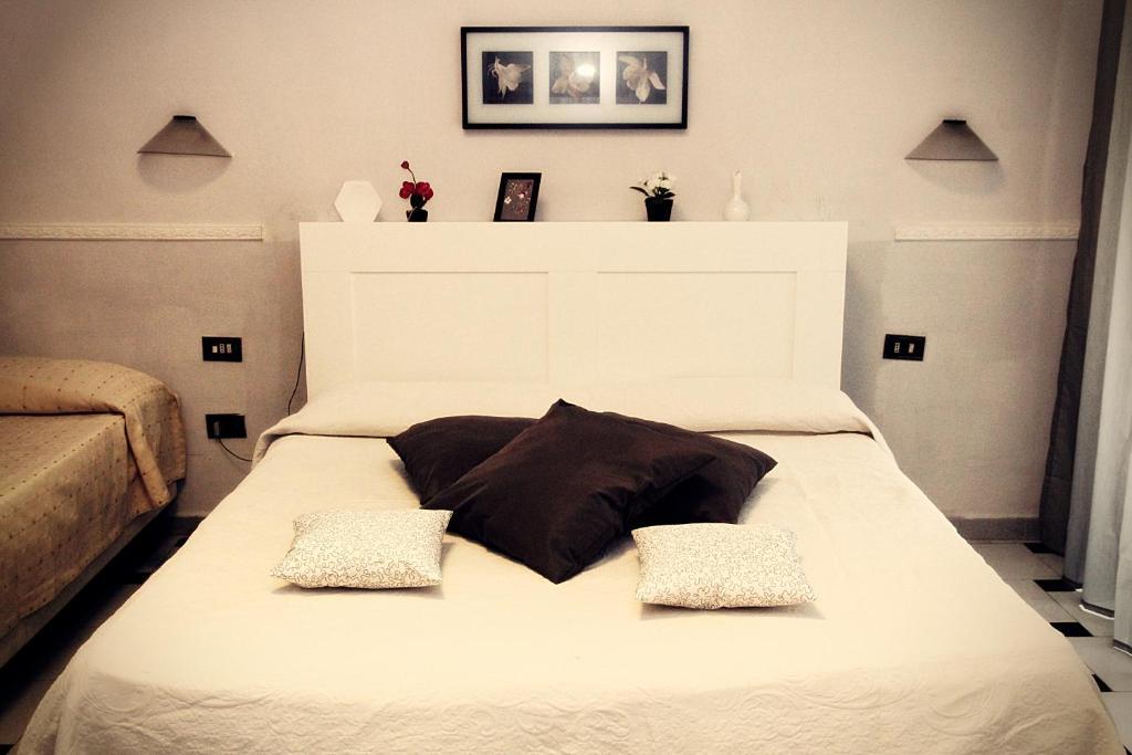 Letto o letti in una camera di Hotel Luna Rossa