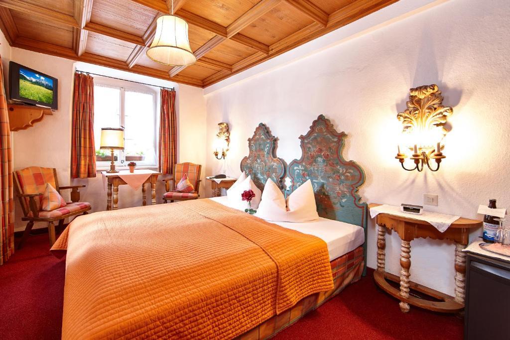 Ein Bett oder Betten in einem Zimmer der Unterkunft Alpenrose