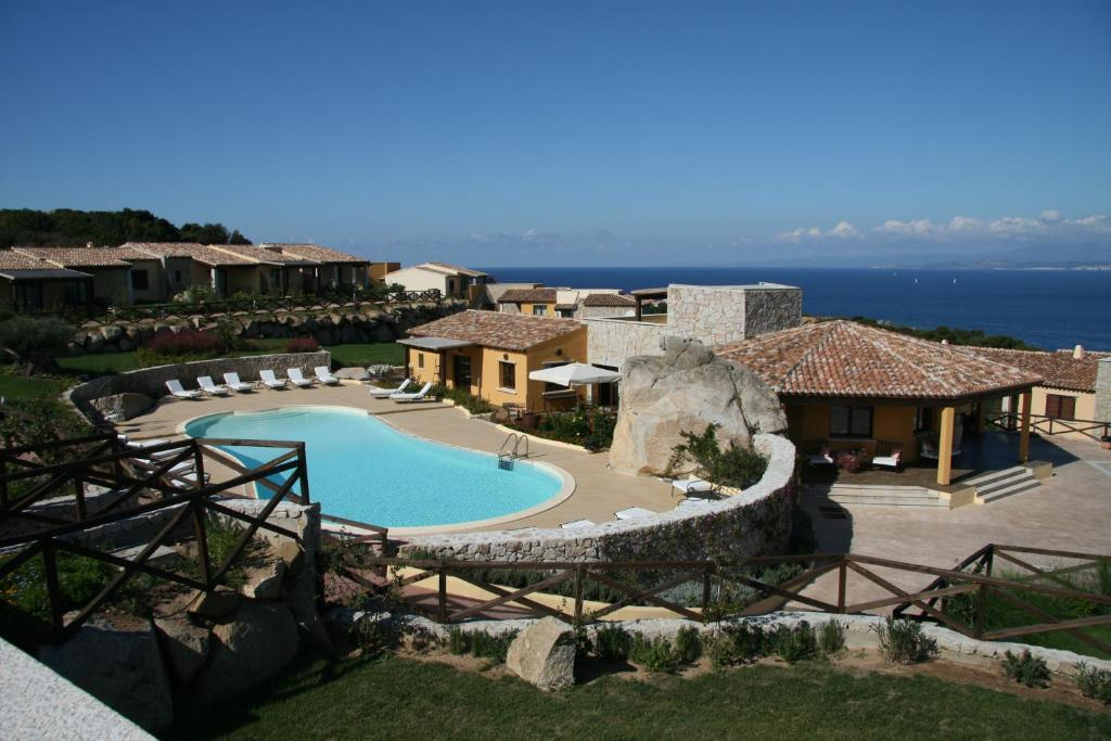 A view of the pool at Punta Falcone Resort or nearby