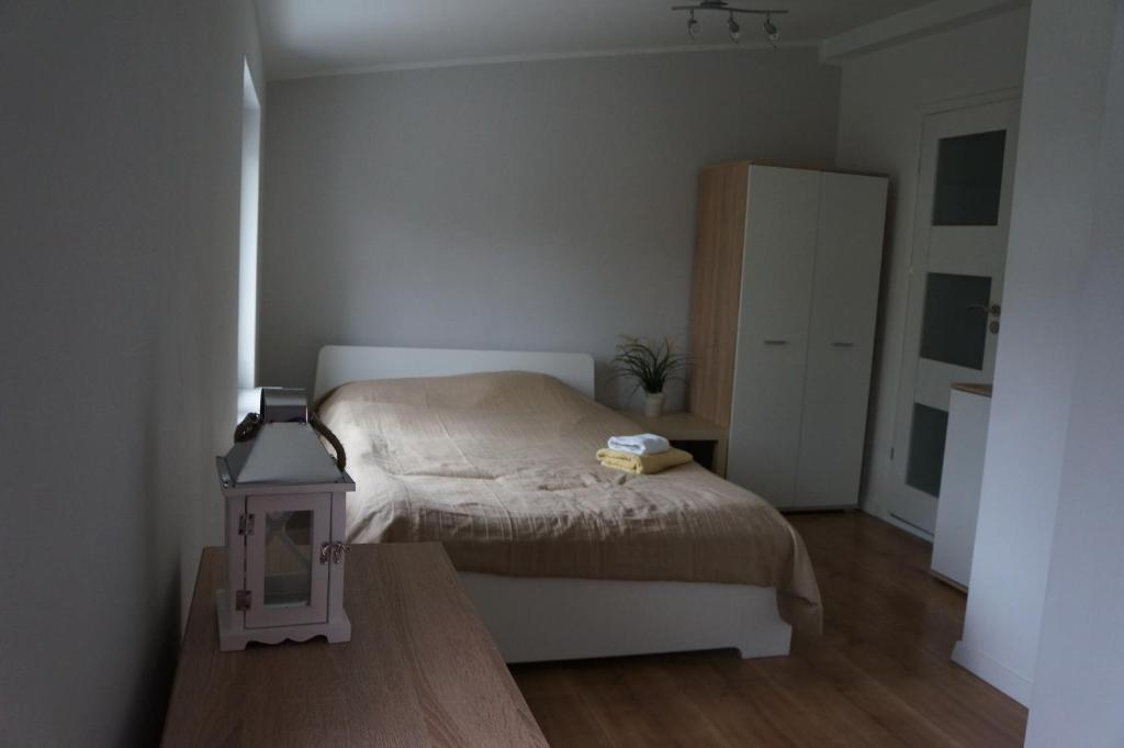 Łóżko lub łóżka w pokoju w obiekcie Apartamenty z klimatem