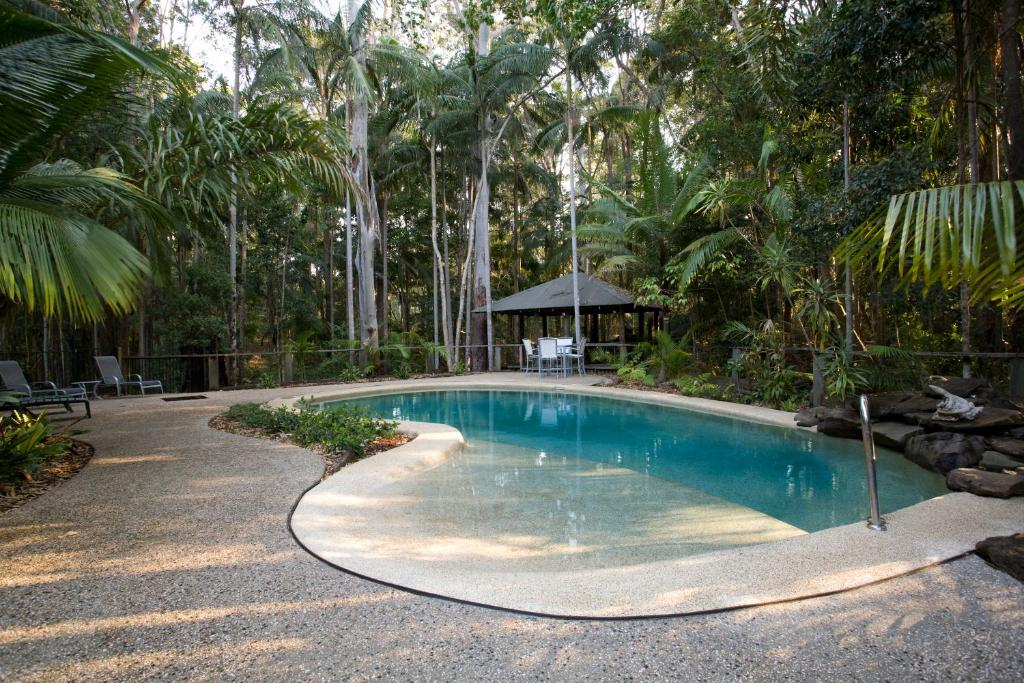 The swimming pool at or near Amore On Buderim Rainforest Cabins
