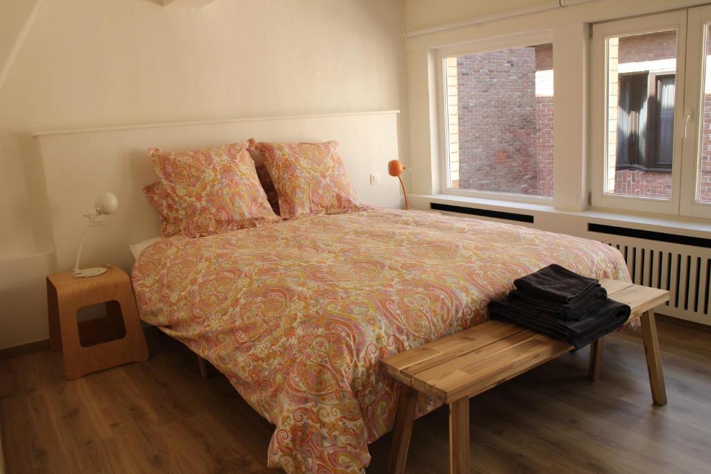 Een bed of bedden in een kamer bij Chocolou