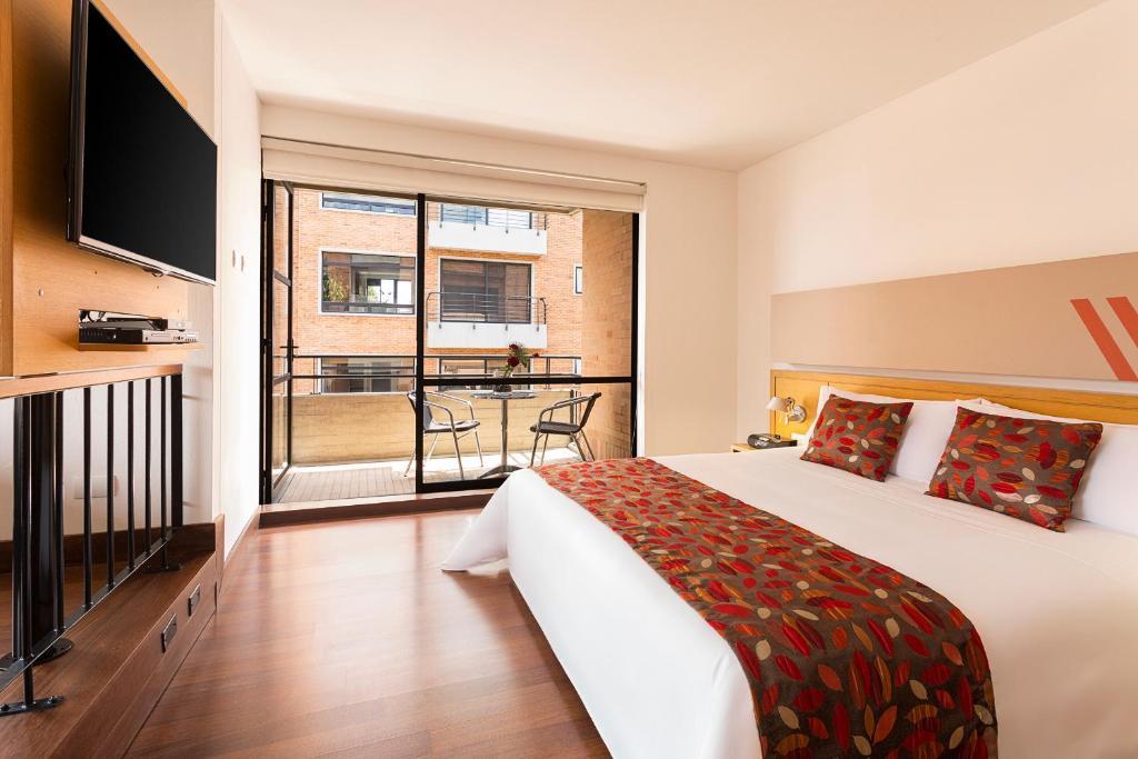 Cama o camas de una habitación en Hotel bh La Quinta