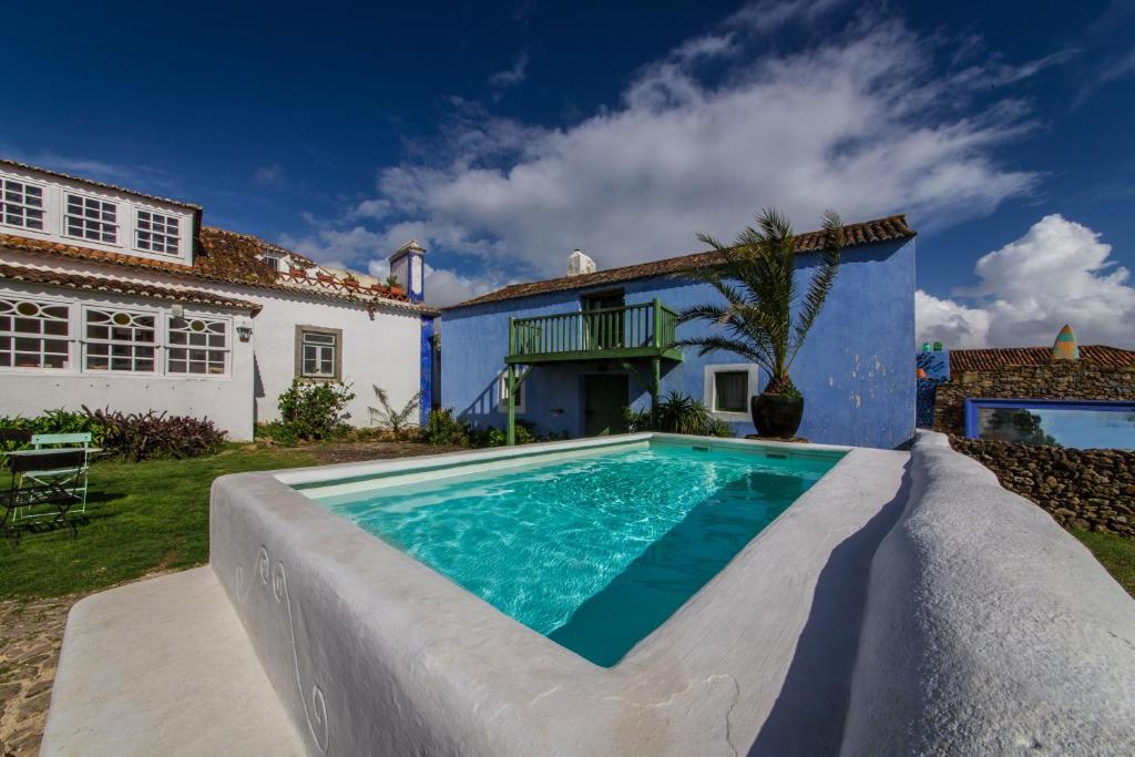 The swimming pool at or near Casa Paço D`Ilhas