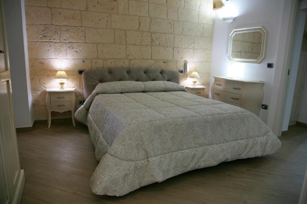 Letto o letti in una camera di L'Angolo del Salento