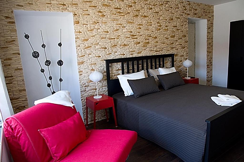 Postel nebo postele na pokoji v ubytování Apartments Centrum