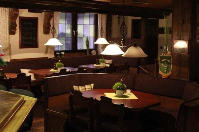 A restaurant or other place to eat at Landhotel Restaurant Schützenhof