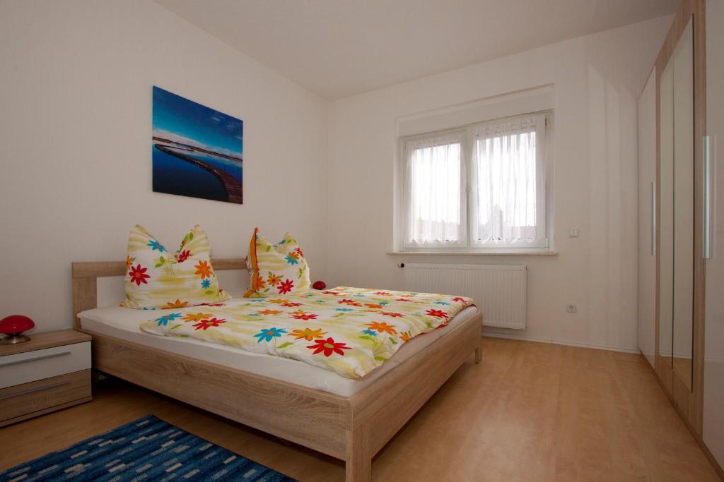 Ein Bett oder Betten in einem Zimmer der Unterkunft Roßtrappensicht