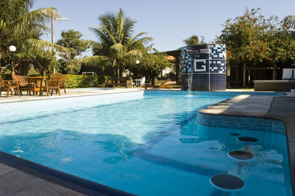 The swimming pool at or near Hotel GAPH Maringa - Economico