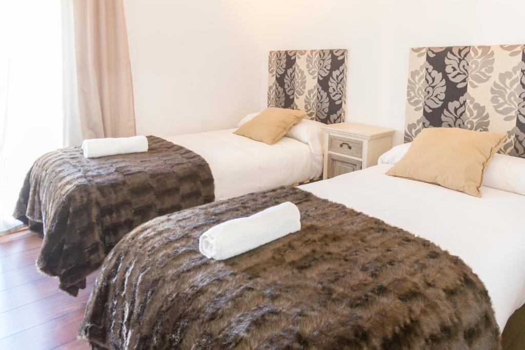 Cama o camas de una habitación en Autèntic Barcelona Monumental