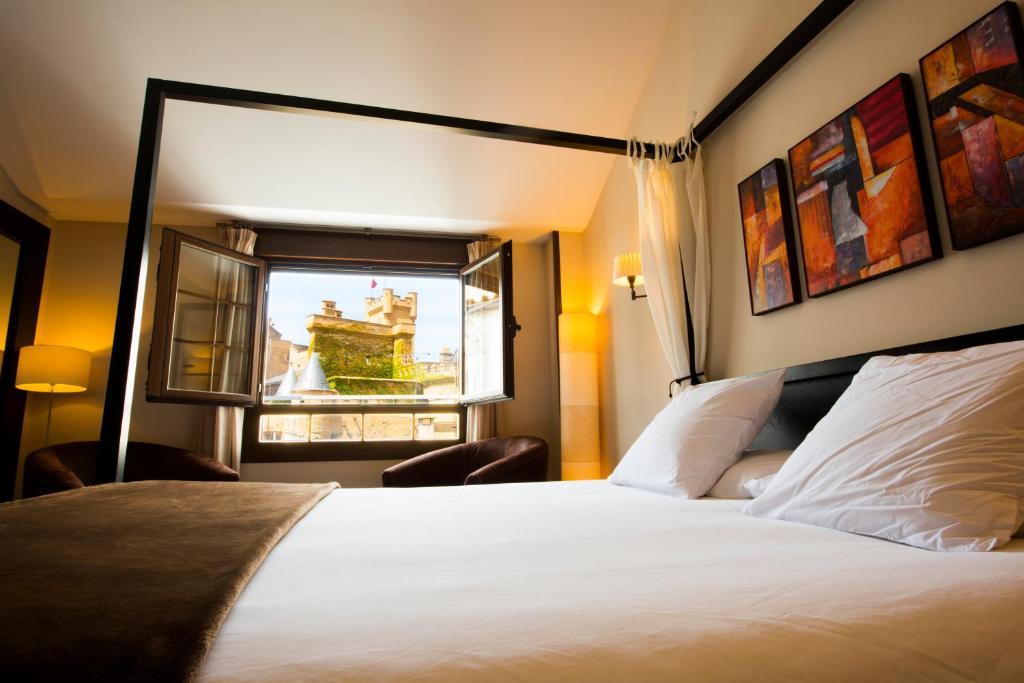 Cama o camas de una habitación en Hostal Rural Villa Vieja