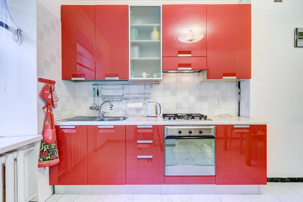 Кухня или мини-кухня в Welcome Home Apartments Nevskiy 54