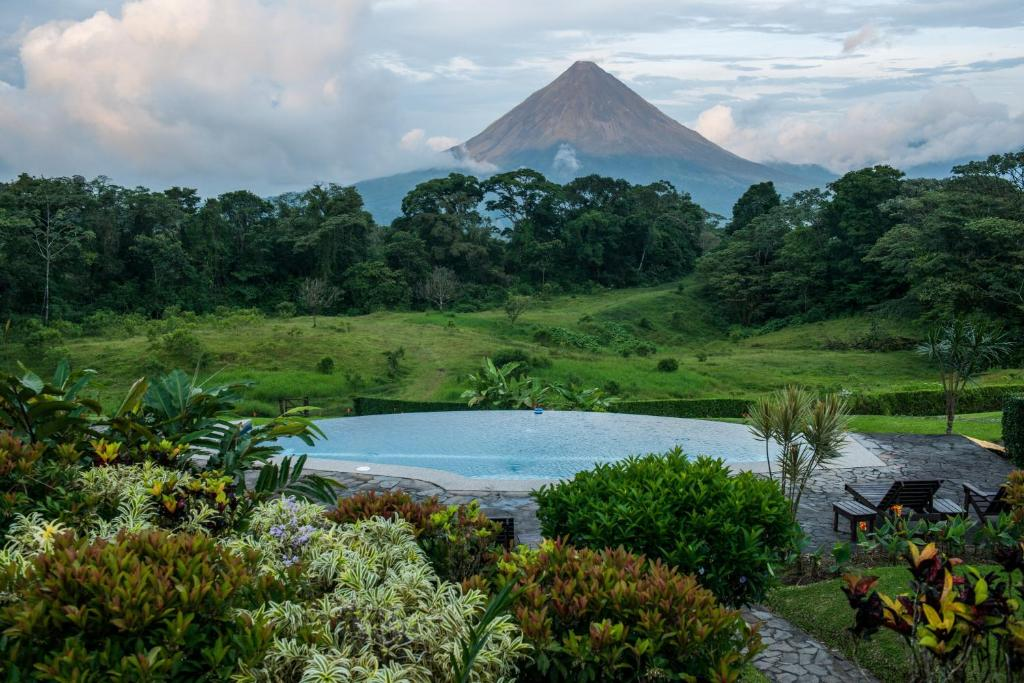 The swimming pool at or near Hotel Arenal Lodge