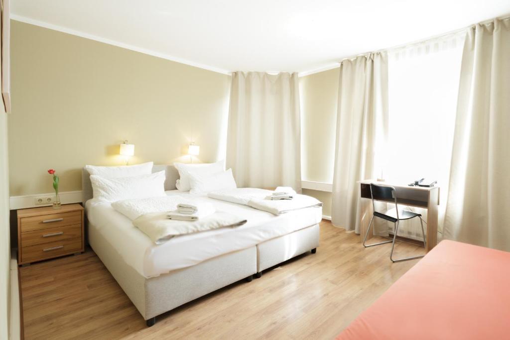 Krevet ili kreveti u jedinici u okviru objekta Hotel Pankow