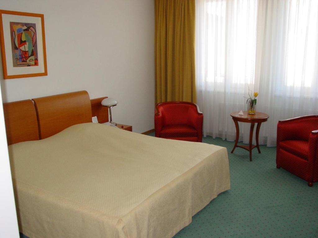 Кровать или кровати в номере Hotel Exel