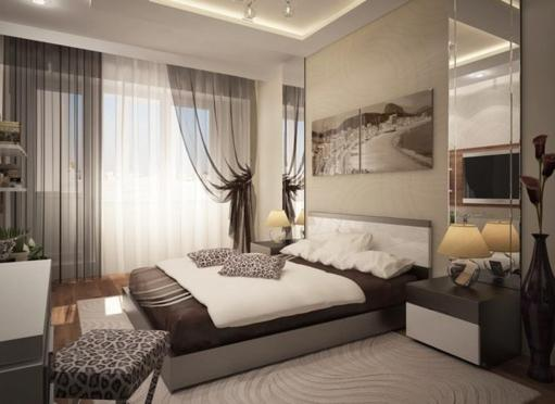 A bed or beds in a room at Pleasure Apartment near center of Odessa