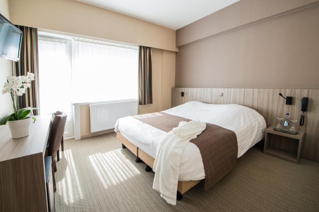 Een bed of bedden in een kamer bij Hotel Princess