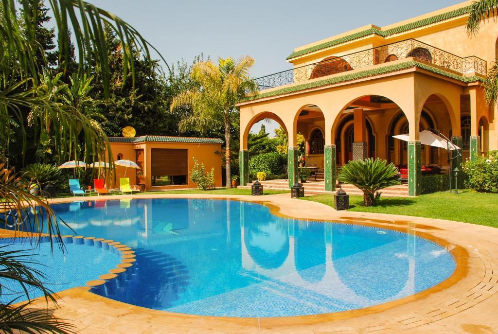 The swimming pool at or near Riad Noumidya