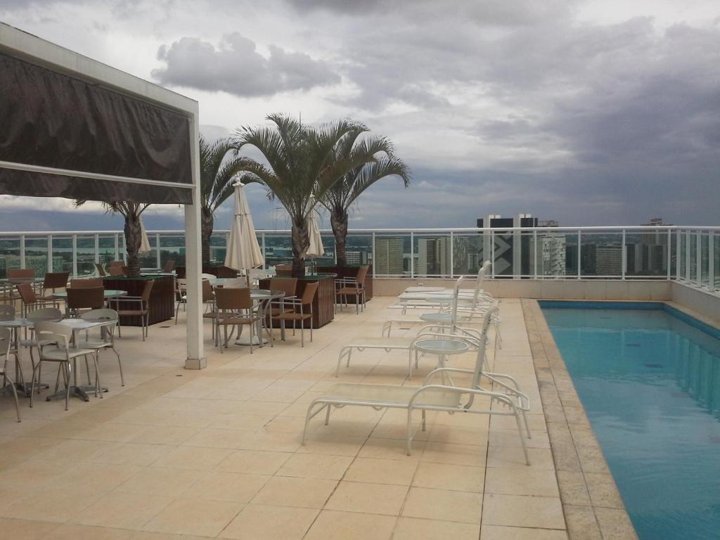 A piscina localizada em Flat no Coraçao de Brasilia ou nos arredores