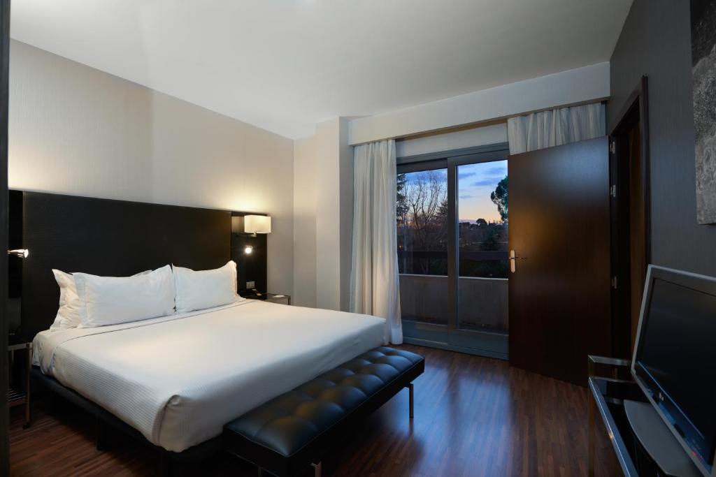 Cama o camas de una habitación en Eurostars Monte Real