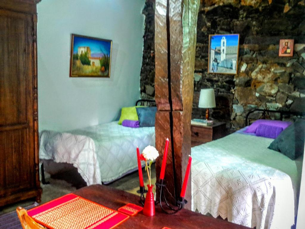 A bed or beds in a room at Isminis Petroktisto Holidays Stonehouse