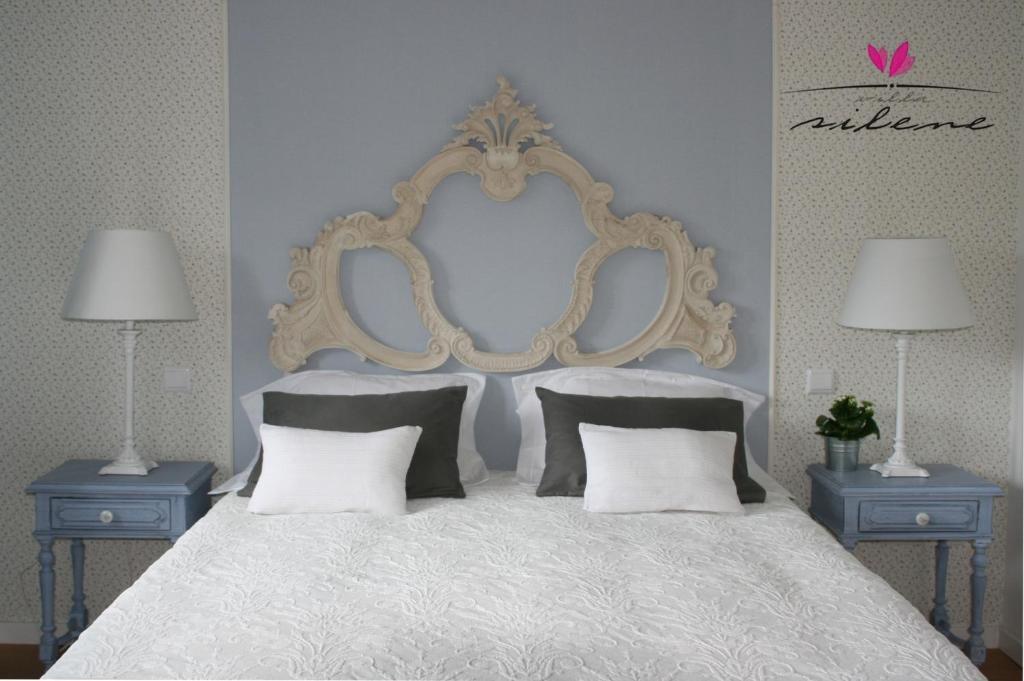 Uma cama ou camas num quarto em Villa Silene