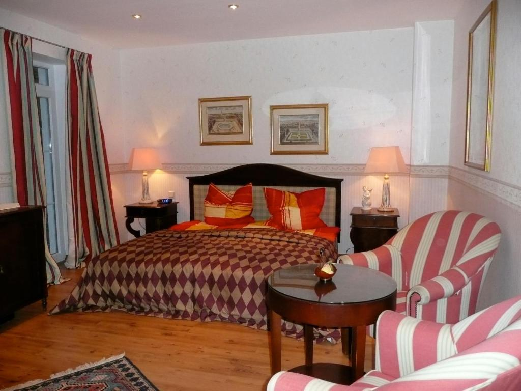 En eller flere senge i et værelse på Das Romantische Landhaus