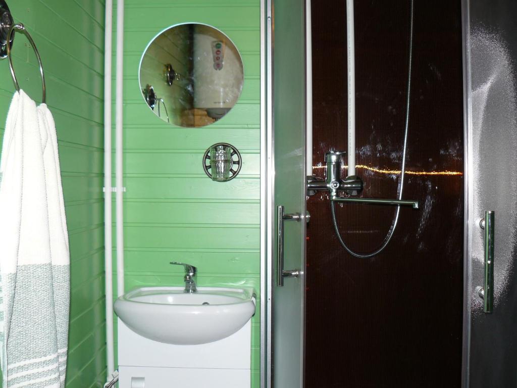 Ванная комната в Guest house Tihaya ulochka