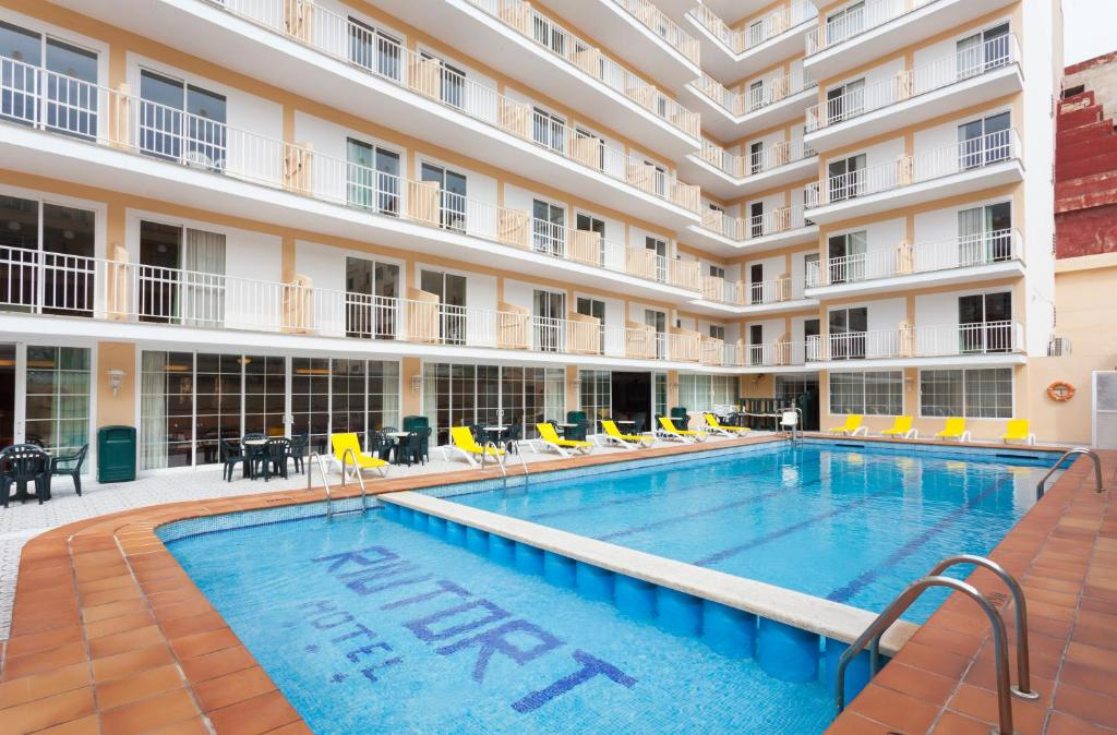 The swimming pool at or near Hotel Riutort