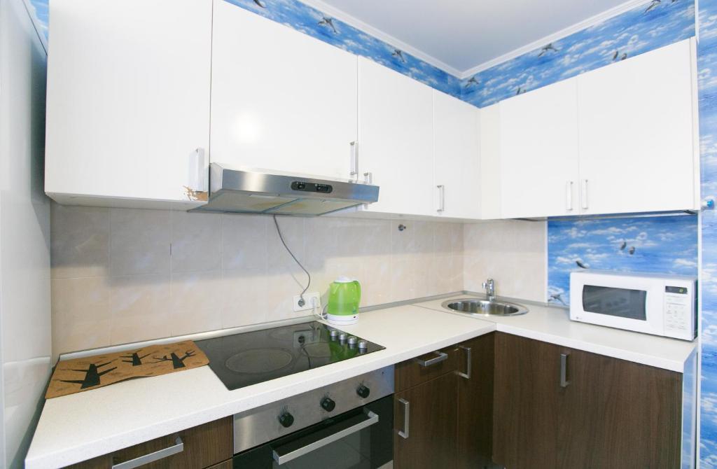 Кухня или мини-кухня в DearHome Trubetskaya