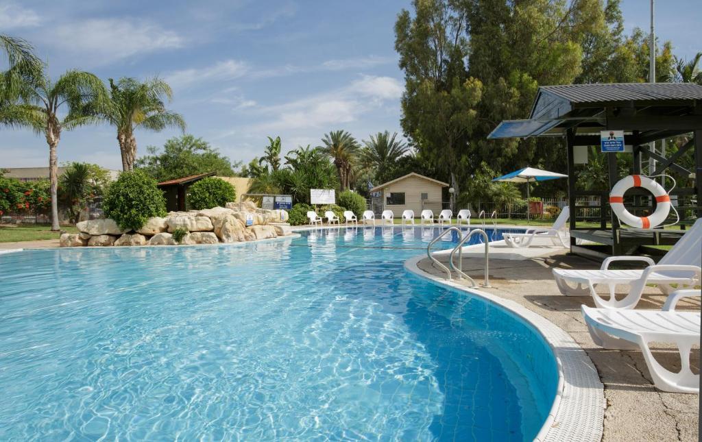 The swimming pool at or near Nof Ginosar Kibbutz Hotel