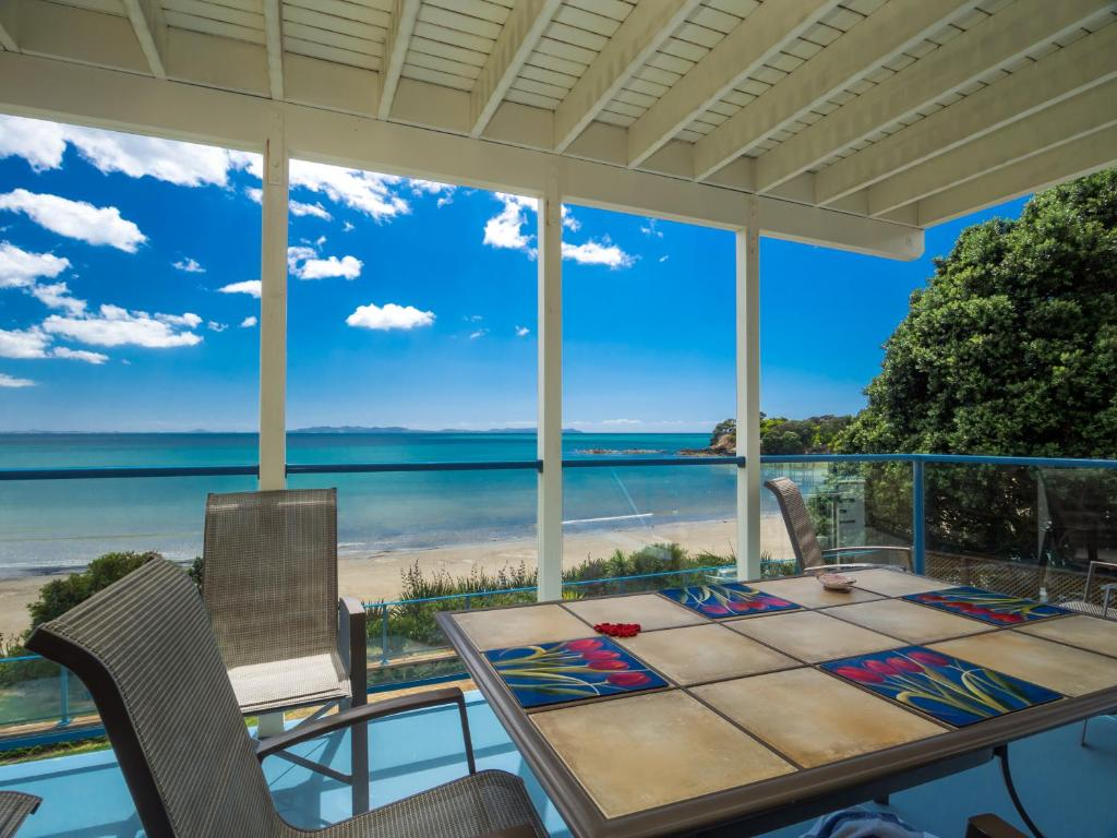 A balcony or terrace at By the Bay Beachfront Apartments