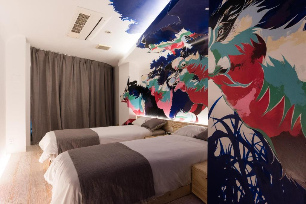 A bed or beds in a room at Artist Hotel - BnA HOTEL Koenji